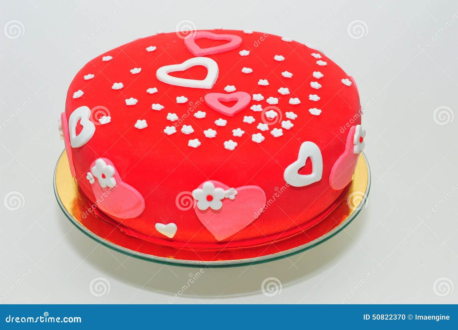 Valentinsgrußherz- und -blumenkuchen
