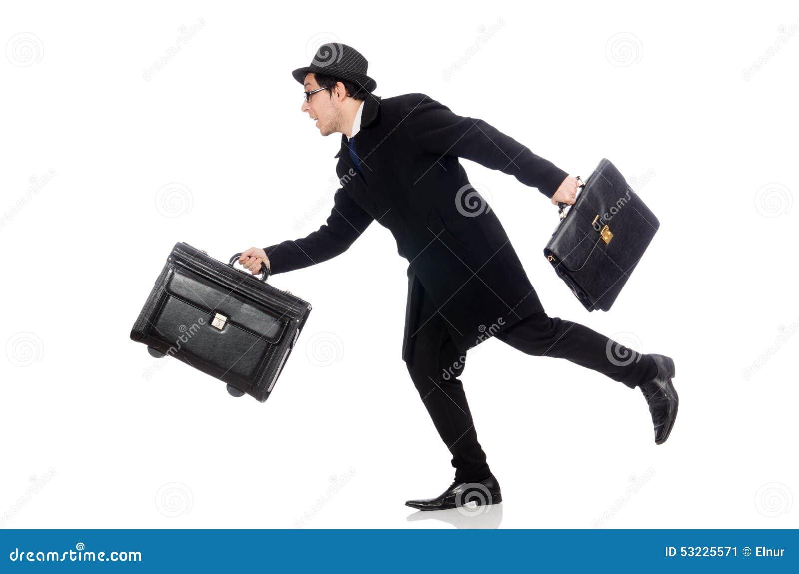 Valigia della tenuta del giovane isolata su bianco