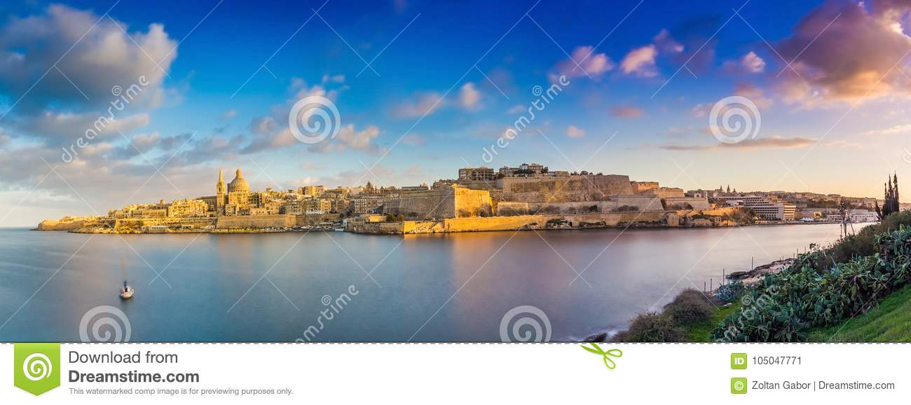 Valletta, Malta - Panoramic skyline view of the ancient city of Valletta and Sliema at sunrise shot from Manoel island at spring