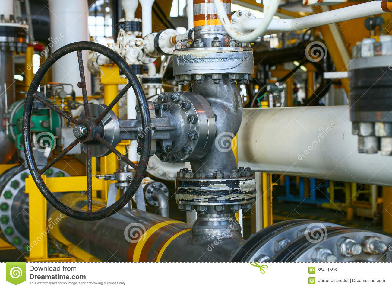 Valves manual in the process. Production process used manual valve to  control the system, duplex valve or stainless steel valve in oil and gas  process and ...