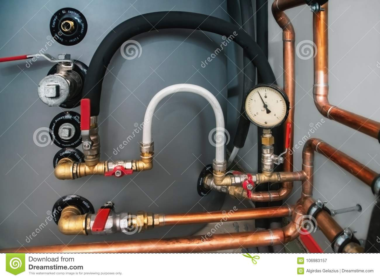 Valves Pressure Gauge And Copper Pipes In A Boiler Room Words Medium Sensor In French German And Italian Languages Phrases Primary Outlet Cold
