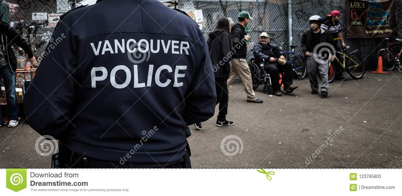 VANCOUVER, BC, CANADA - MAY 11, 2016: Vancouver Police Officer on patrol in an area of heavy drug use and poverty which