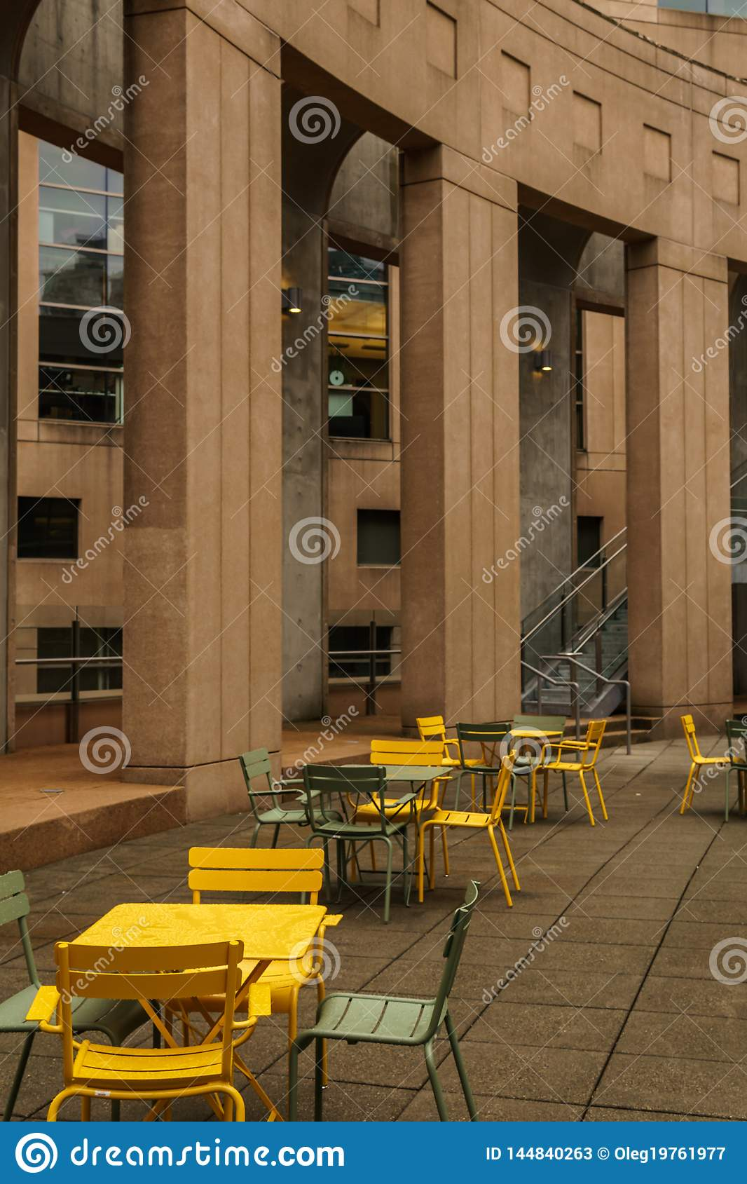 VANCOUVER, CANADA - October 5, 2018: rest zone in the central library with concrete columns armchairs and metal tables