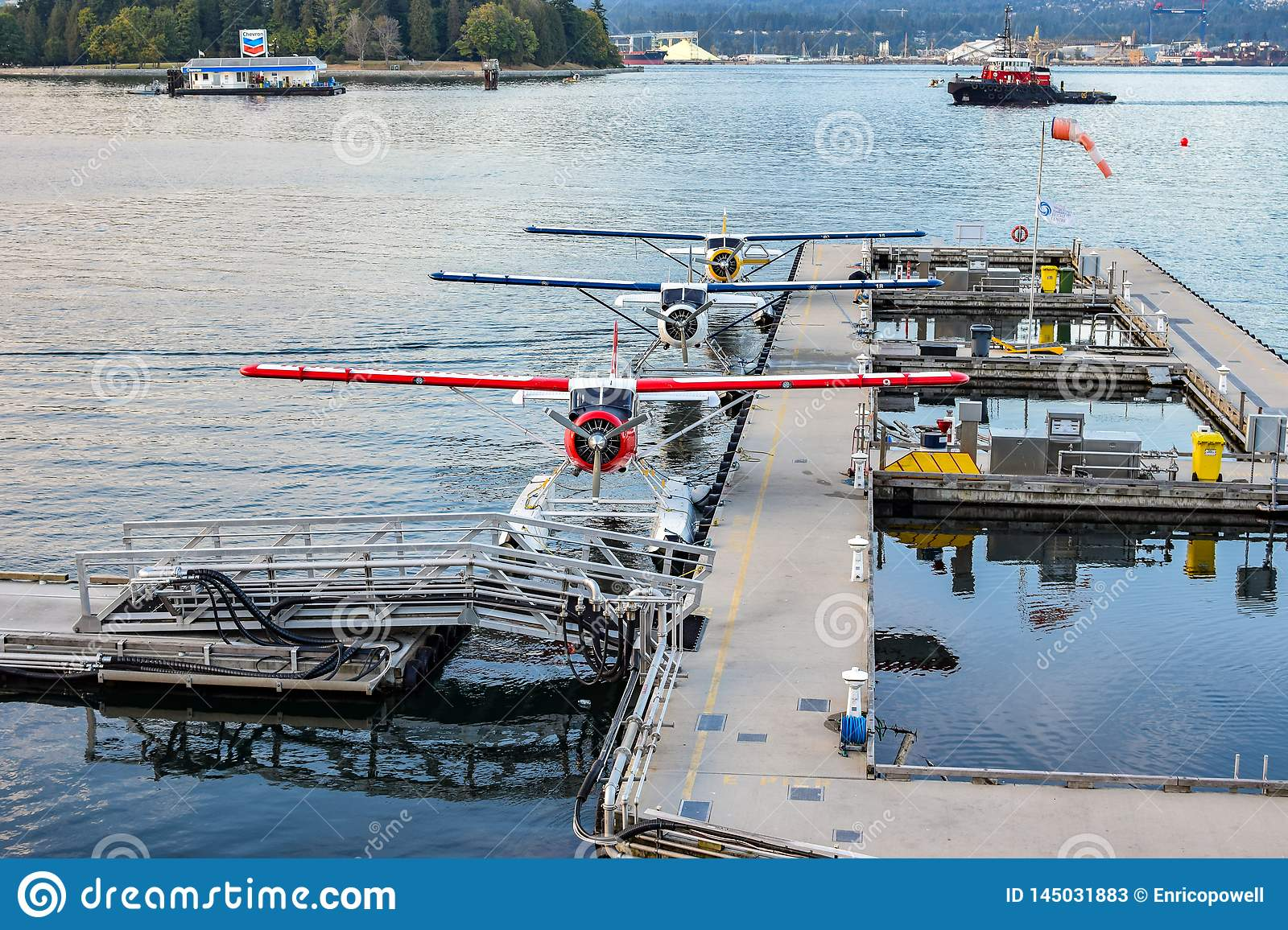 Seaplanes/Float Planes/ Pontoon Planes docked in Coal Harbour, downtown Vancouver, British Columbia