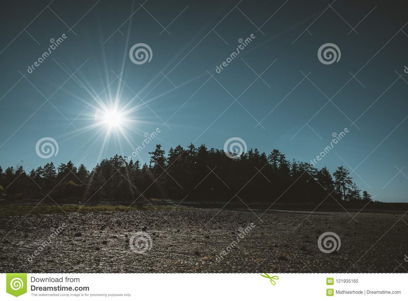 070c2476af709 Vancouver Island beach view on a clear blue sky with sunstar and pacific  coast. Canada