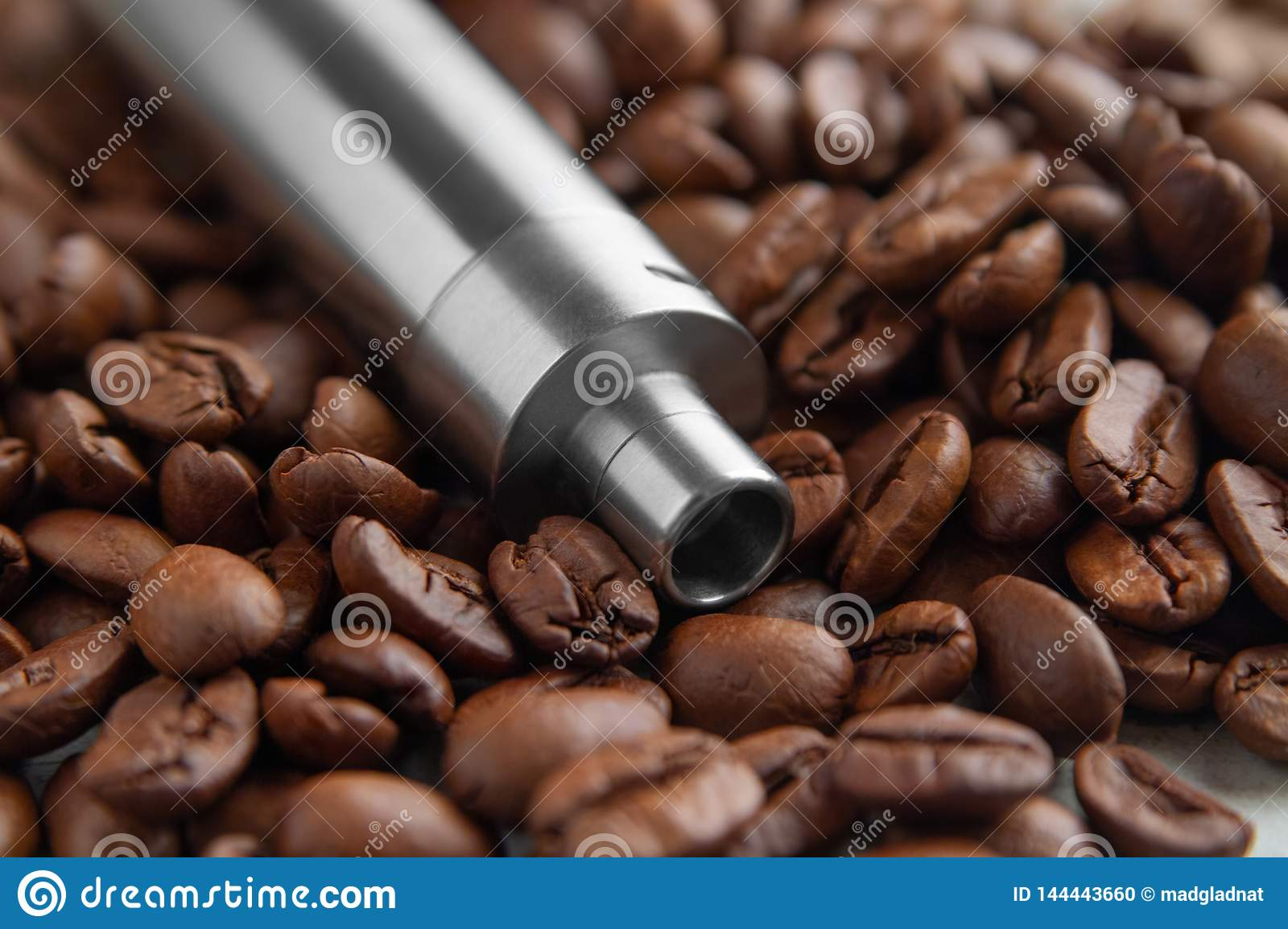 Vape device on the background of coffee beans