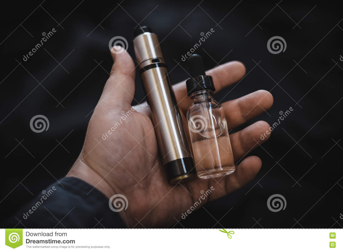 Vaping Device In In The Man`s Hand  Electronic Cigarette