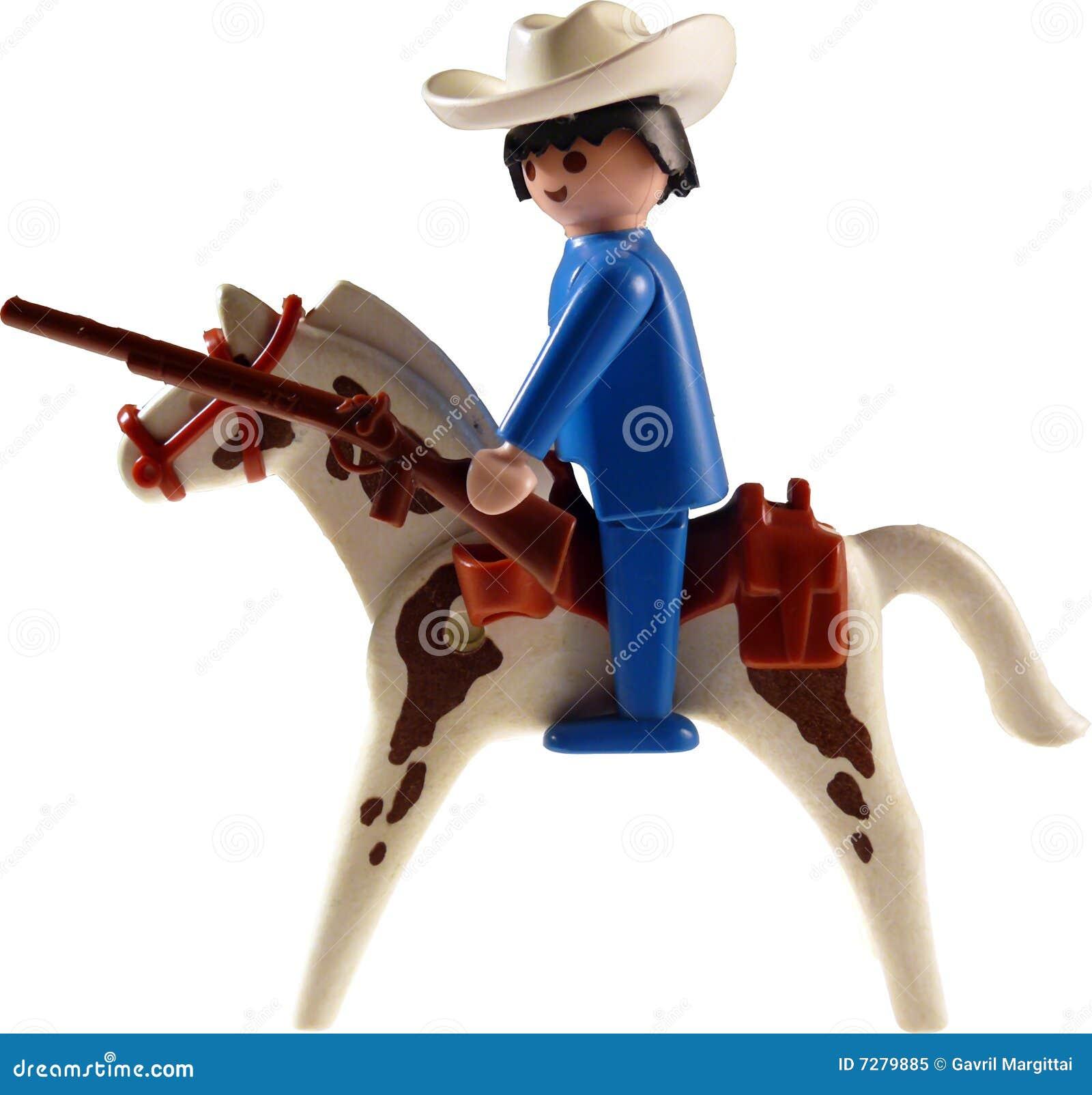 Vaquero del juguete en el caballo aislado