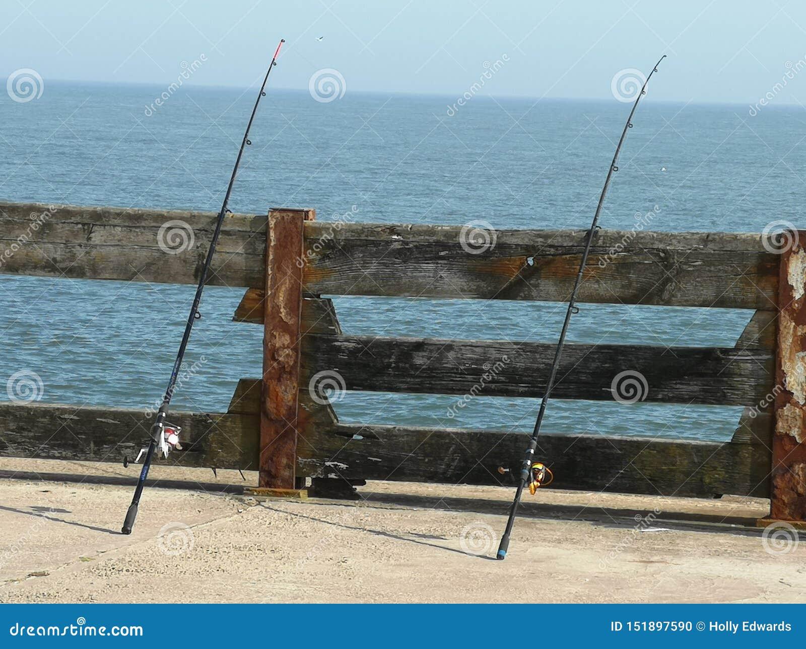Varas de pesca no mar Norfolk