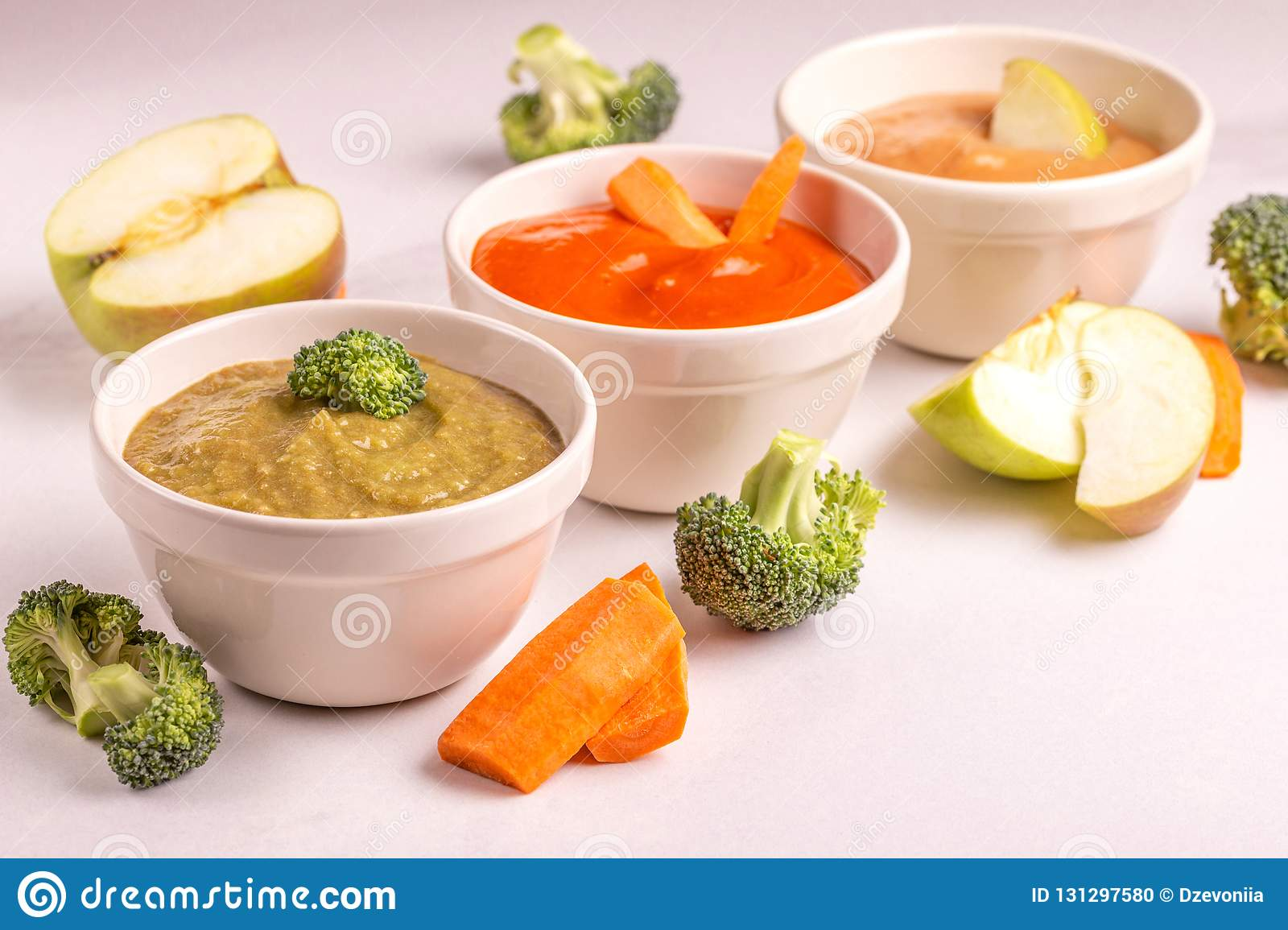 Variation Pureed Baby Food In Clay Bowls With Ingredients Stock