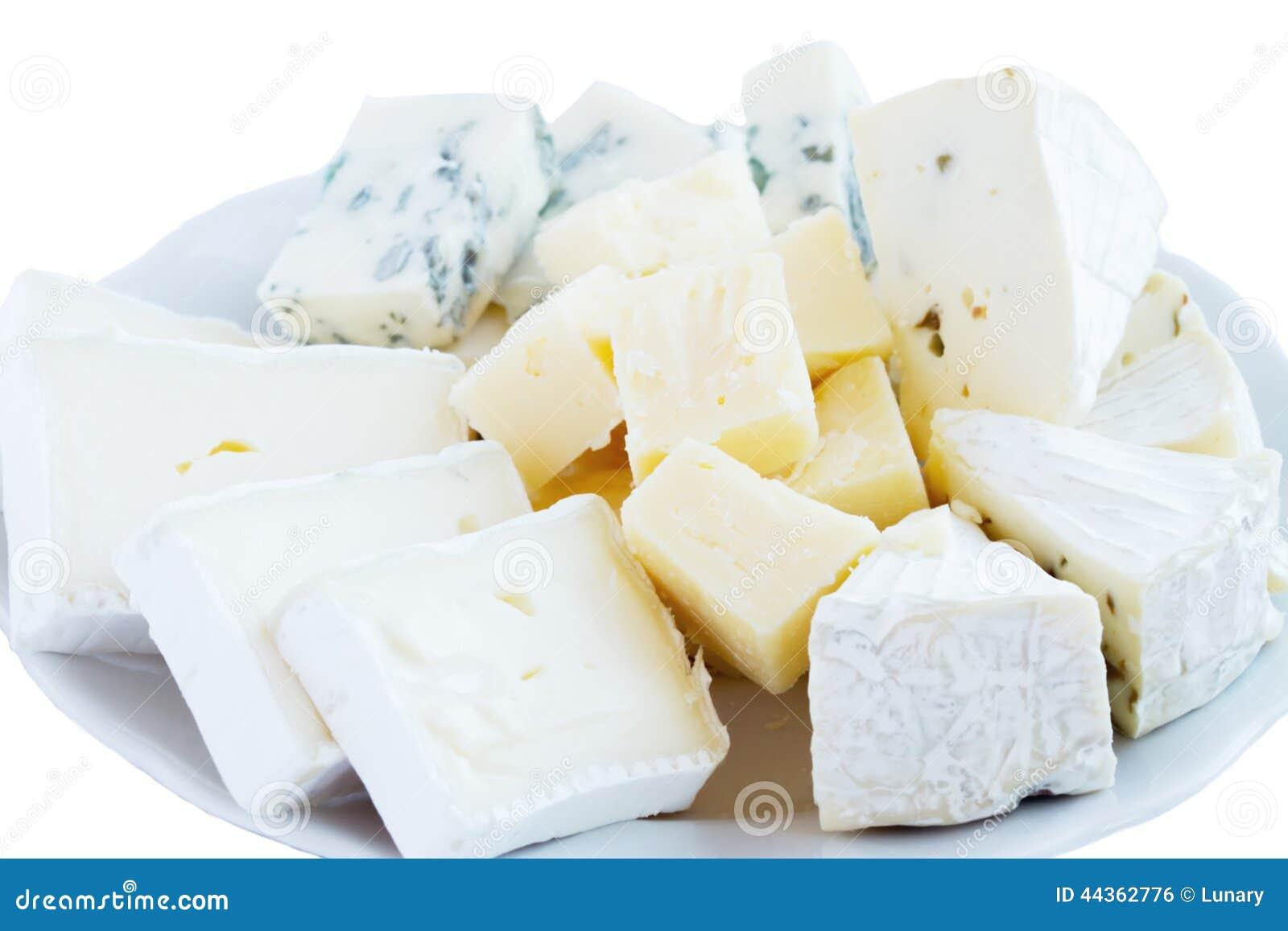 Varietà differenti di formaggio con miele ed i dadi