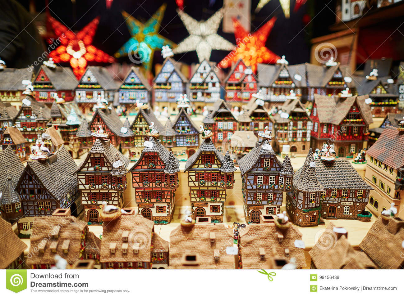 download variety of ceramic houses and star garlands at traditional christmas market in strasbourg stock image - Ceramic Christmas Houses