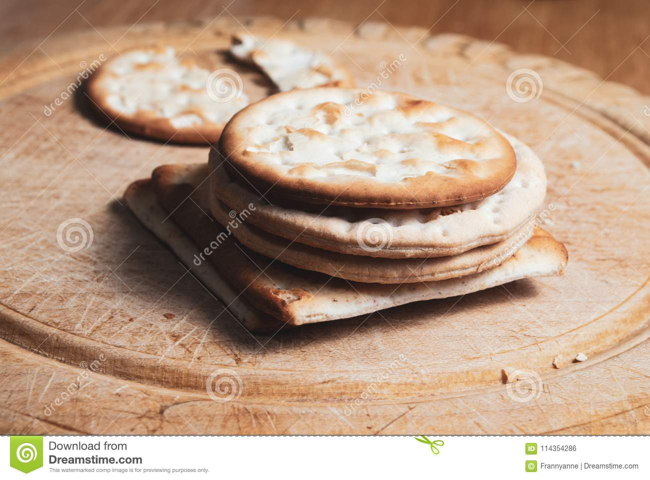 crackers stacked on vintage bread board stock photo image of