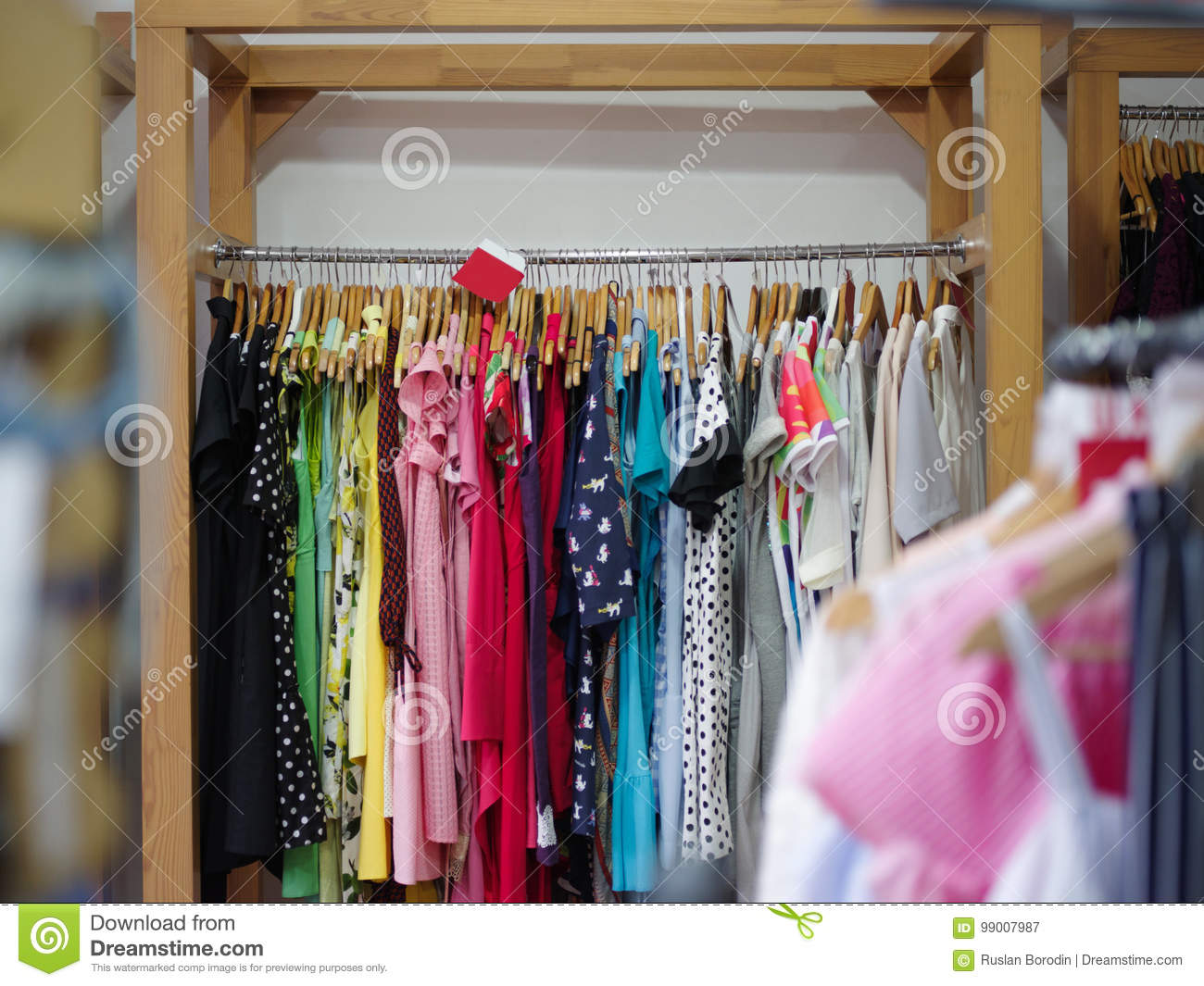 A Big Assortment Colorful Clothes For Women On A Shop Background Various Fashionable Color Shirts And Dresses In A Expensive Boutique