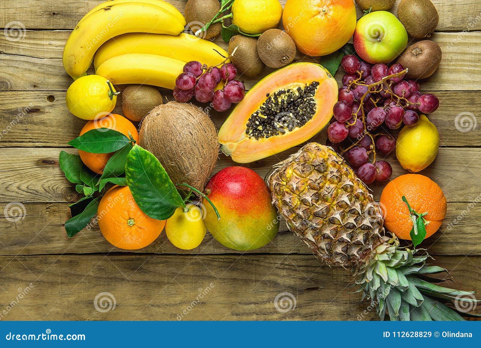 Variety Of Fresh Tropical And Summer Seasonal Fruits Pineapple Papaya Mango Coconut Oranges Kiwi Bananas Lemons Grapefruit On Wood Stock Image Image Of Apples Fruits 112628829