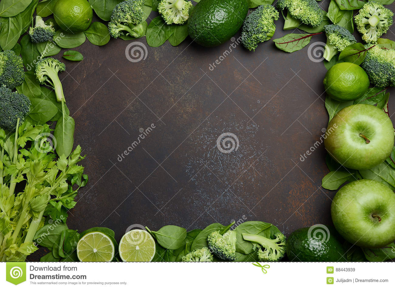 variety of green fruits and vegetables on a dark concrete stone