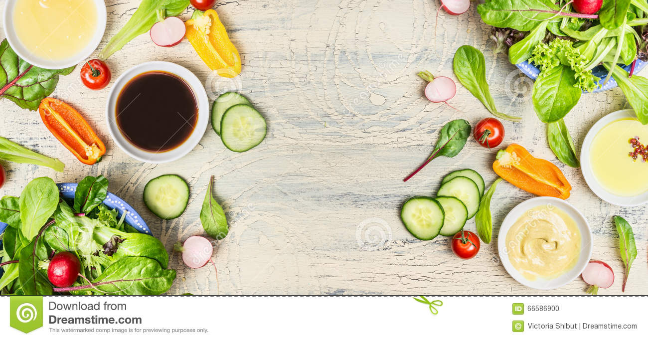 Variety Of Healthy Salad And Dressing Ingredients On Light ...