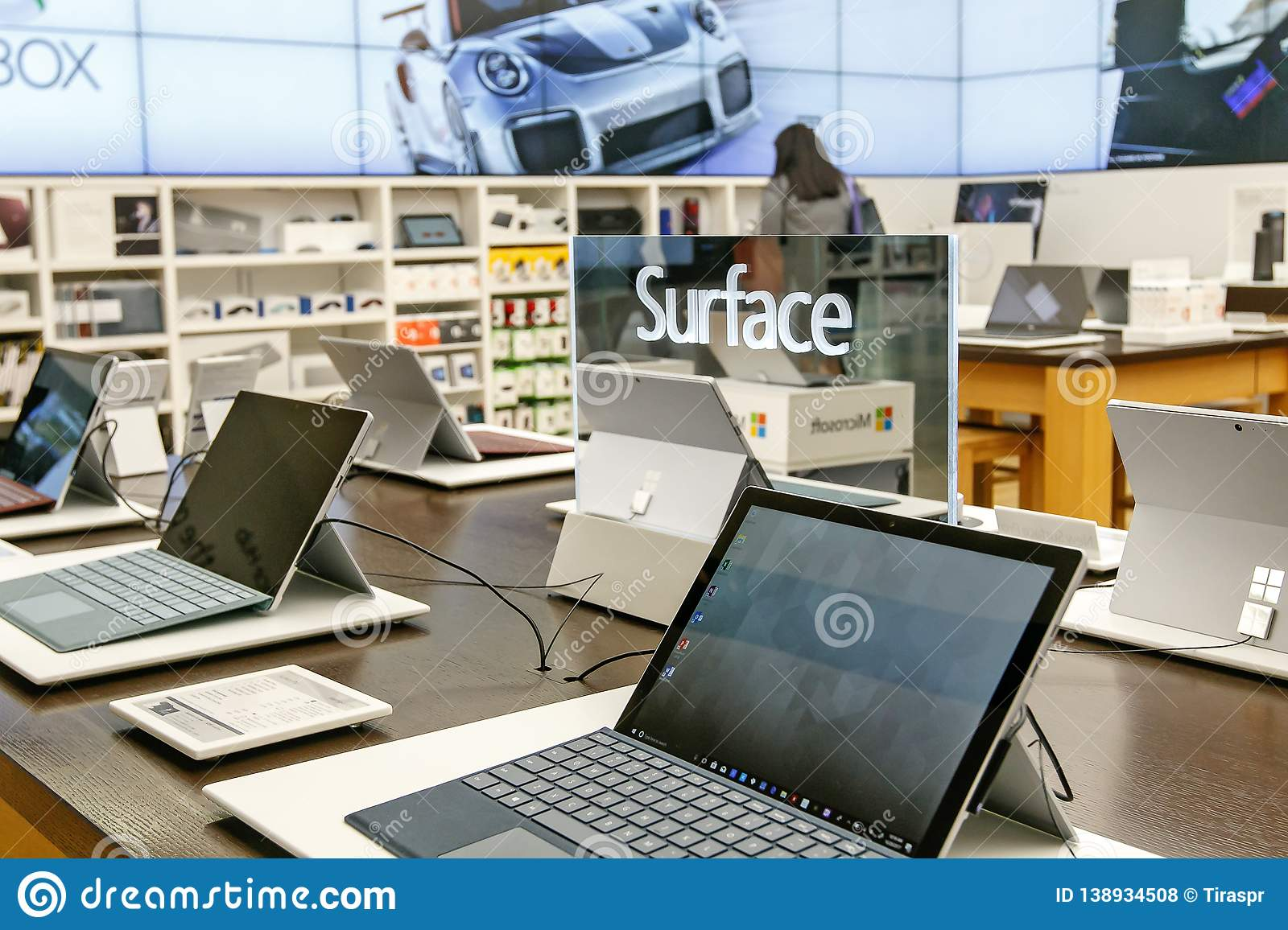 3f4cc2c3902 Variety of laptops running Windows Surface for sale at a Microsoft store in Prudential  Center in Boston