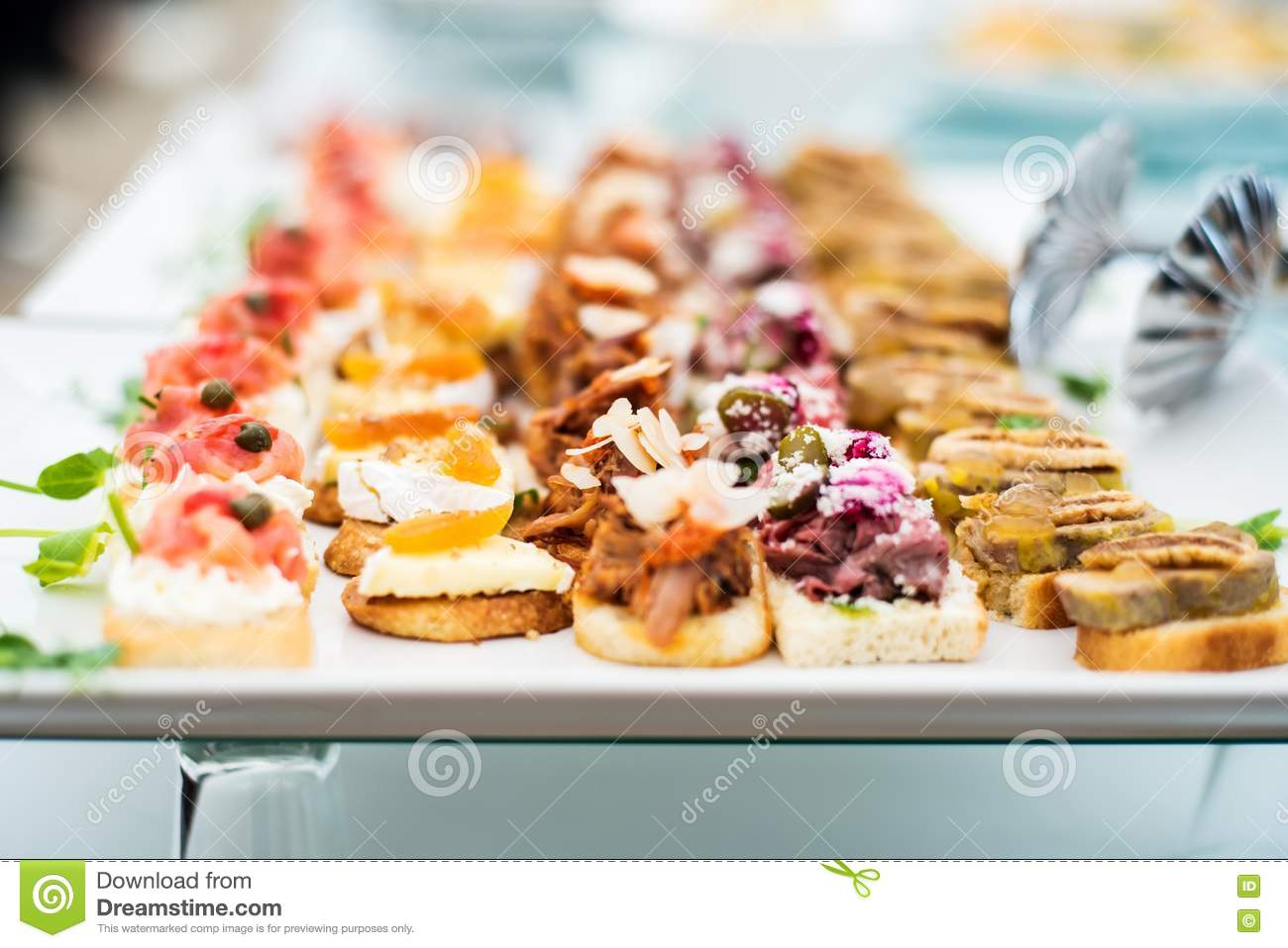 Variety of meat and fish canapes royalty free stock photo for Canape platters