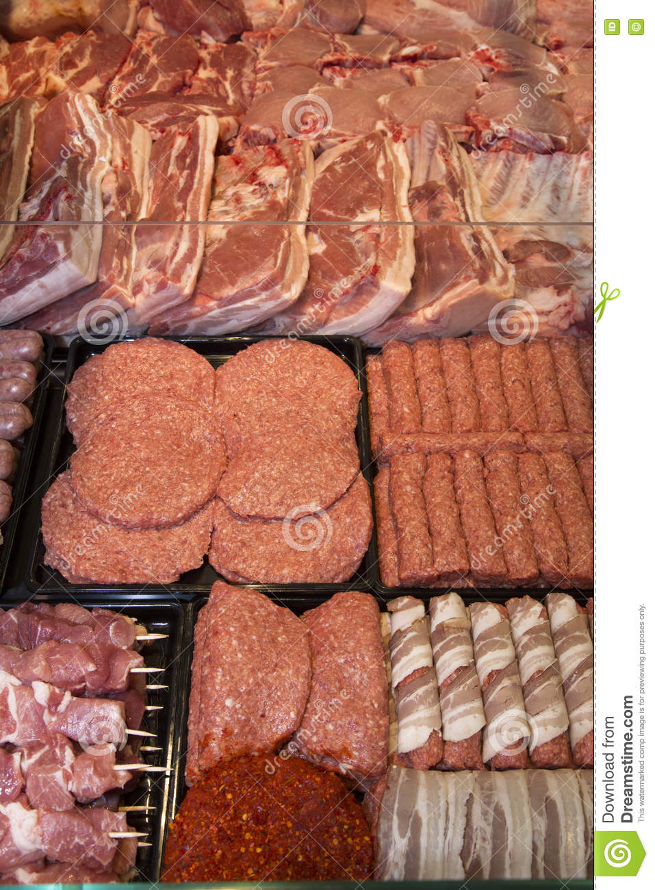Variety Of Raw Meat - Kebabs Of Minced Meat, Beef Patties, Pork Skewers,Kebabs Wrapped In Bacon, Sausages At The Market Place