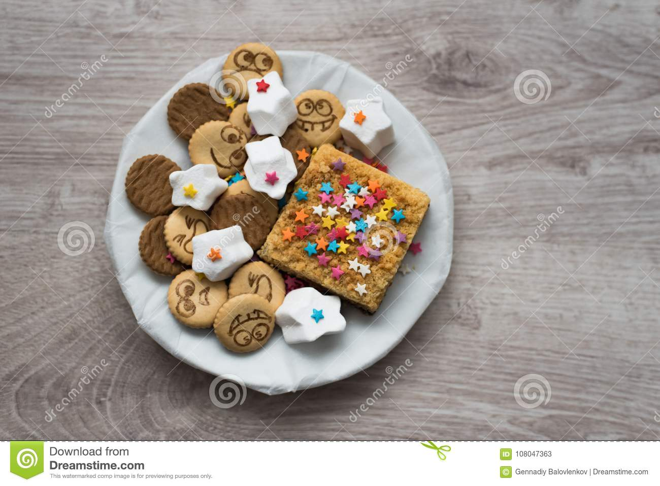 Variety of sweet festive cookies on a wooden background