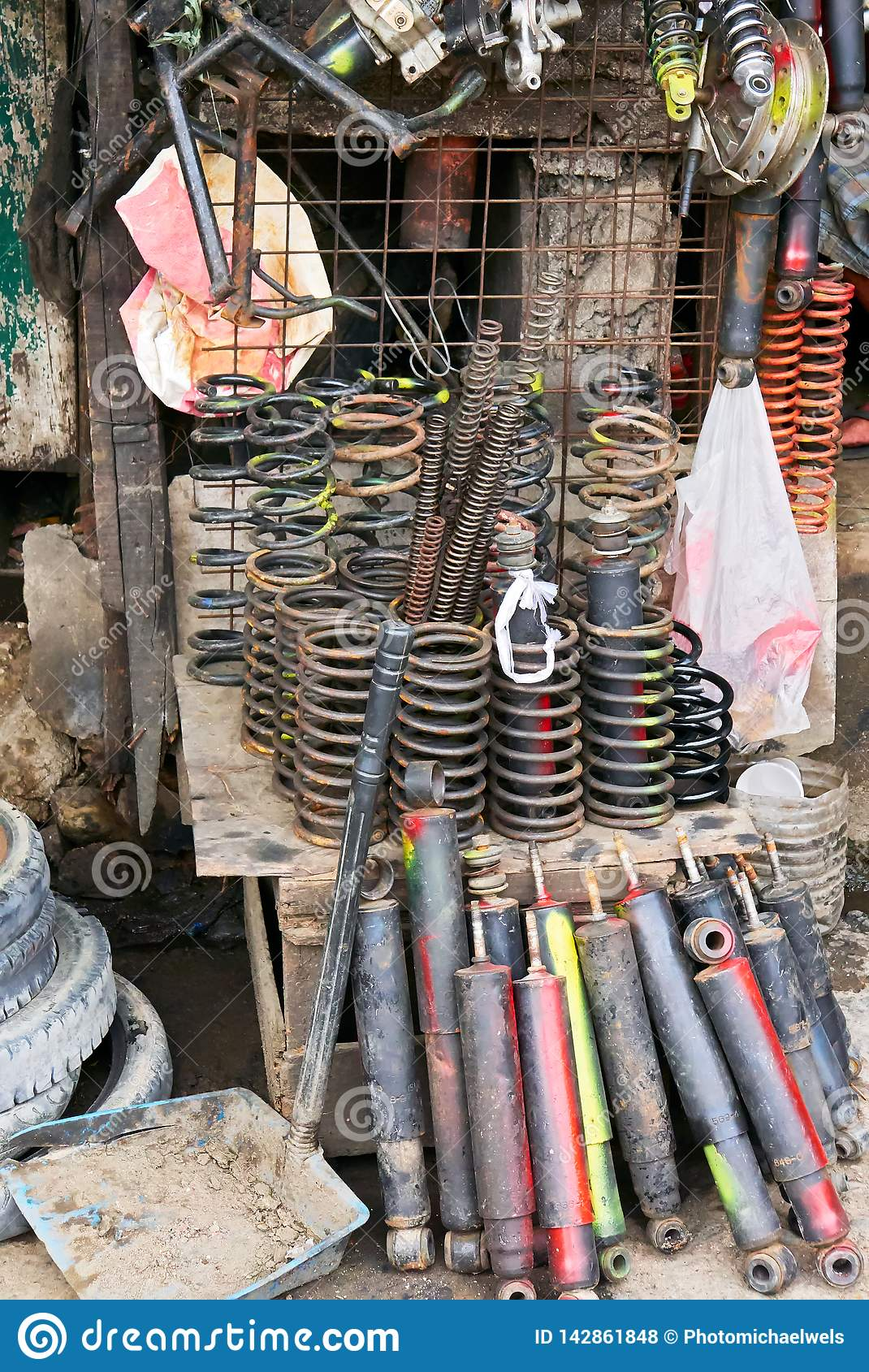 Variety of used auto and motorbike springs at a junk shop