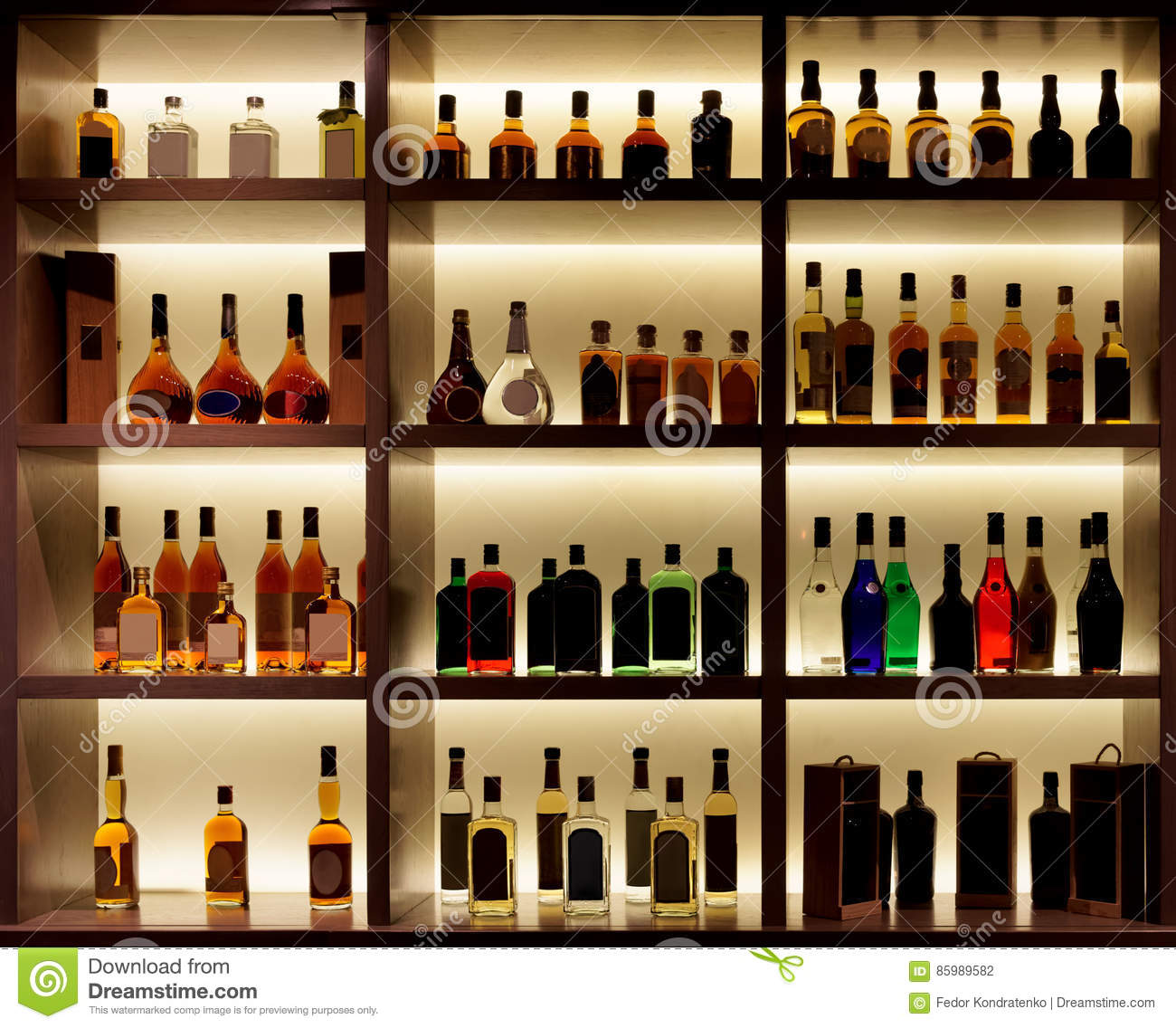 Various Alcohol Bottles In A Bar Back Light Logos Removed
