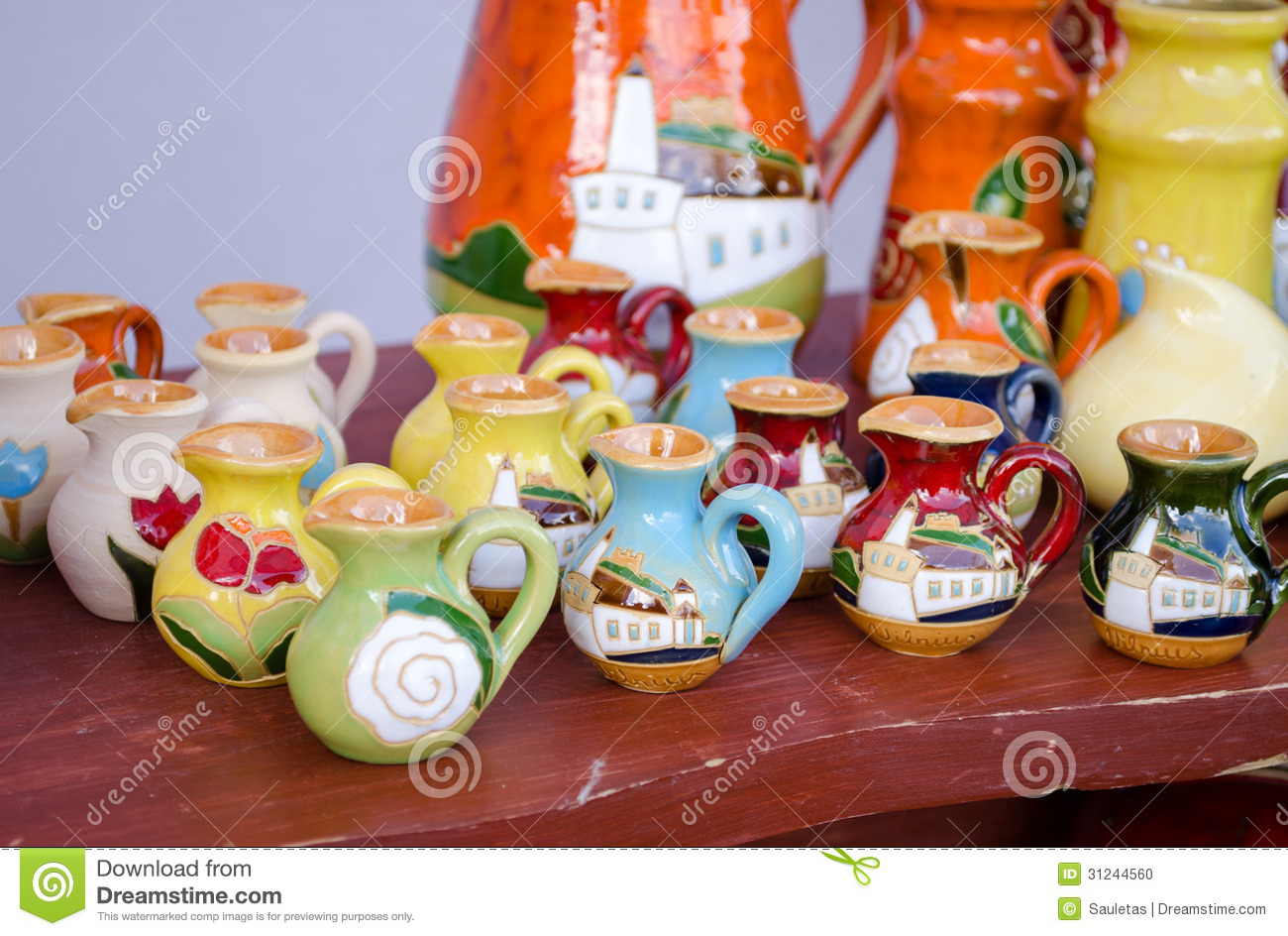Various colorful clay handmade jug jar sell market stock for Crafts for selling at market