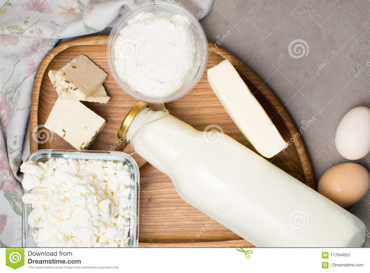 various dairy produkt on grey table with flower towel. Calcium source