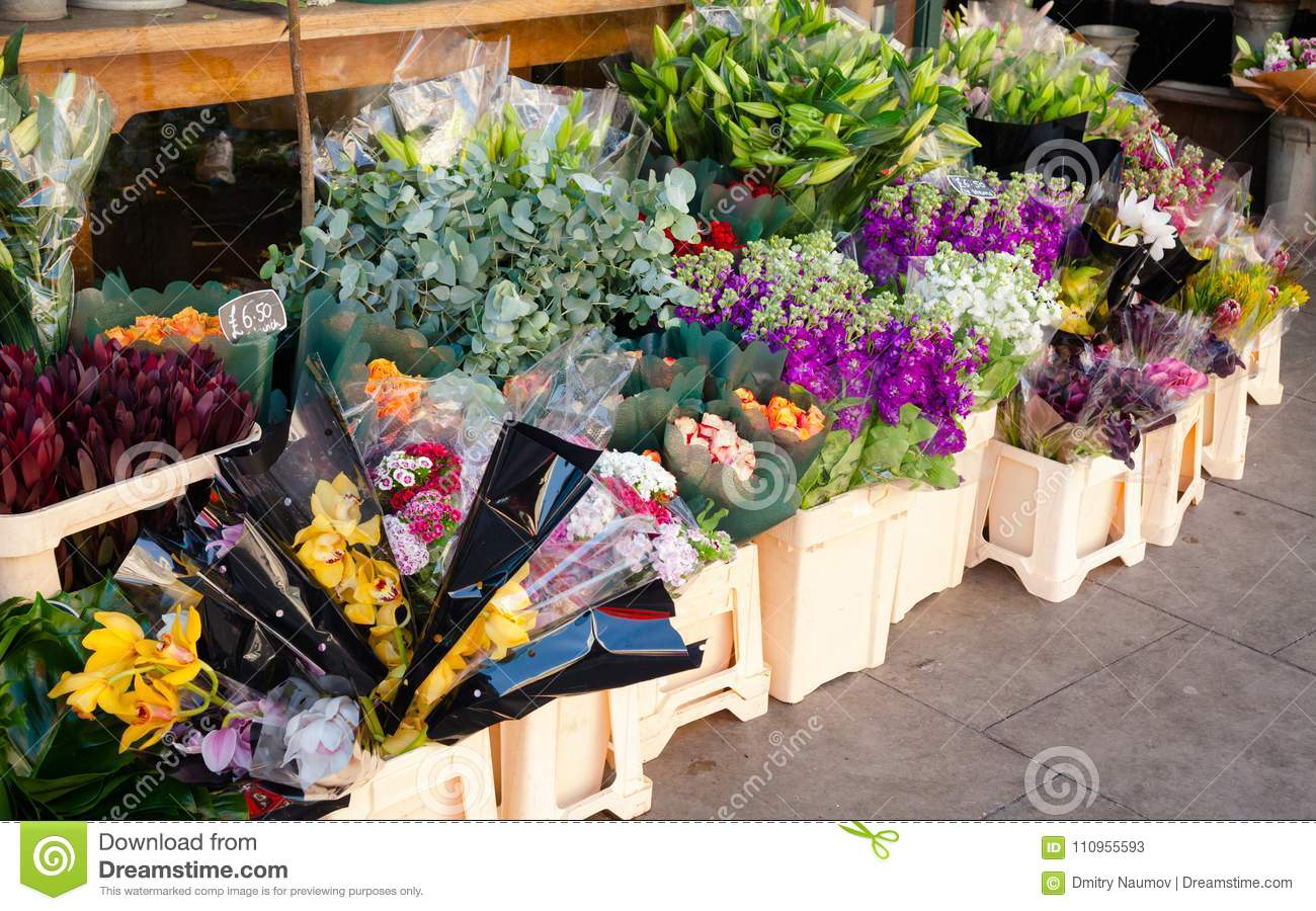 Flowers for sale at street market in england stock image image of various flower bouquets in plastic containers with price tags for sale at a street market in england izmirmasajfo