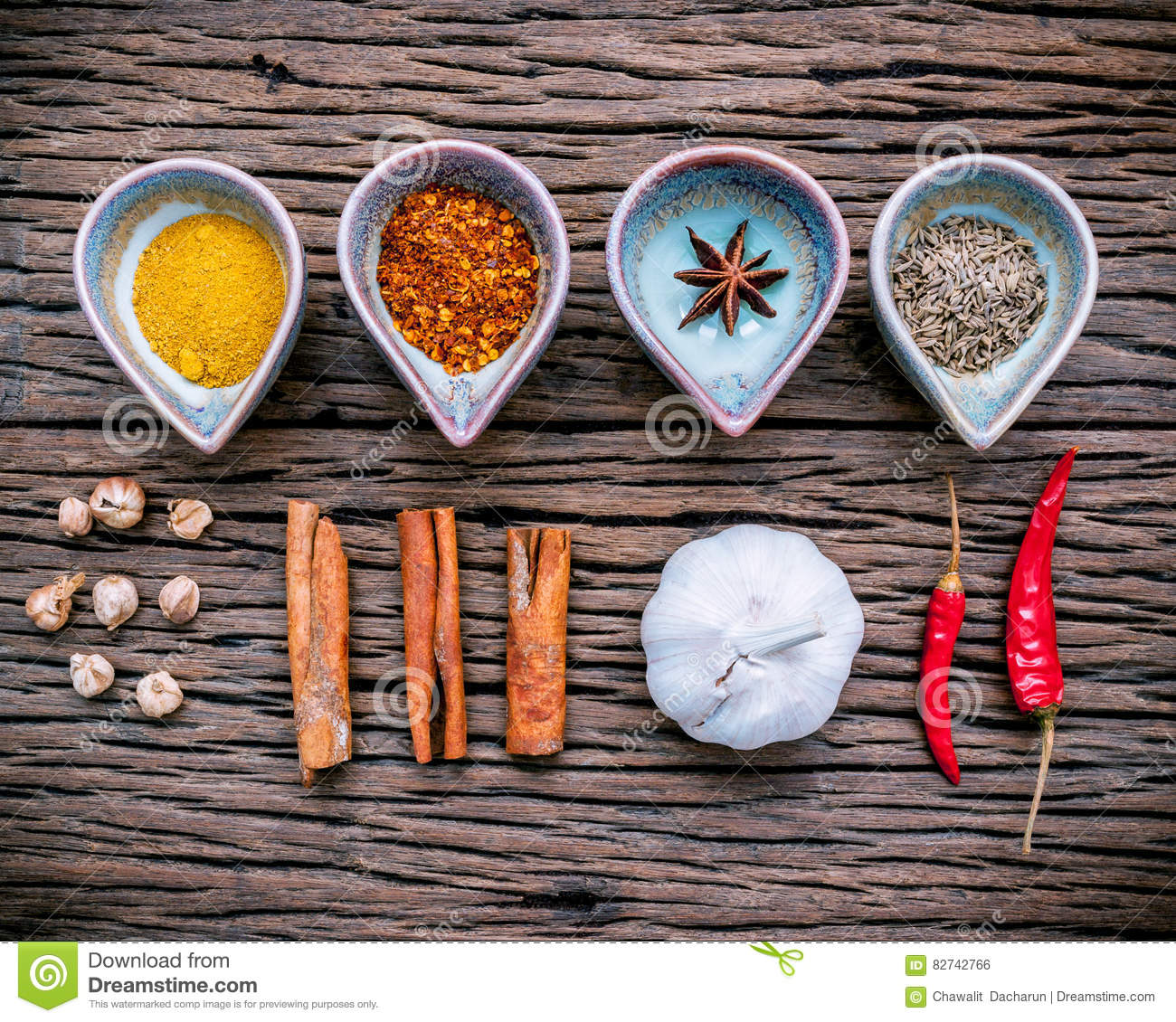 Various herbs and spices in ceramic bowl . Food and cuisine ingredients on rustic wooden background.