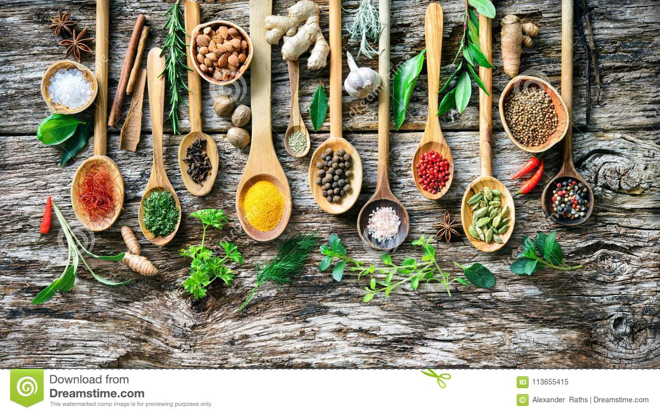 Various herbs and spices for cooking on old wooden board