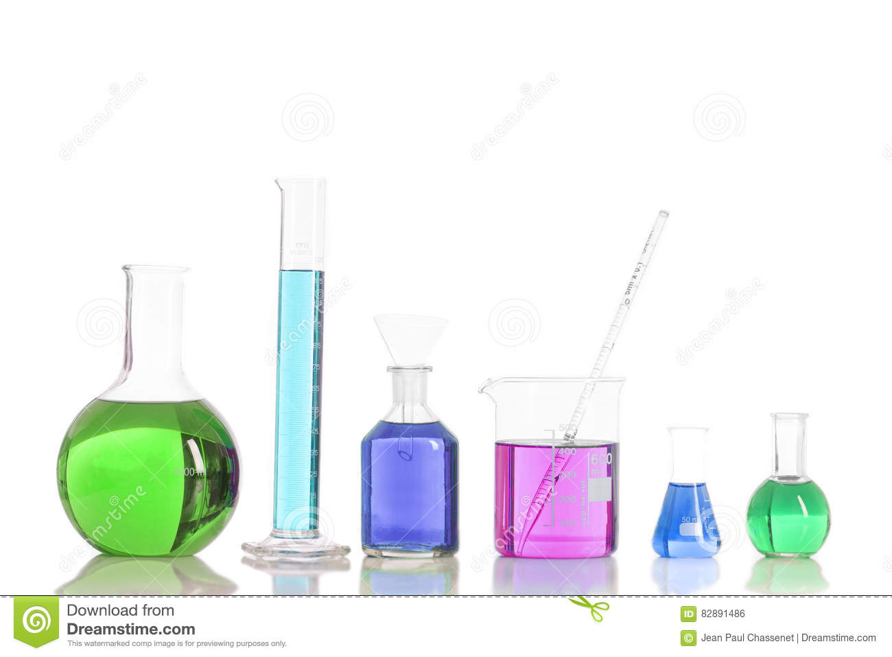 Various laboratory flasks with a colored reagents, pipette