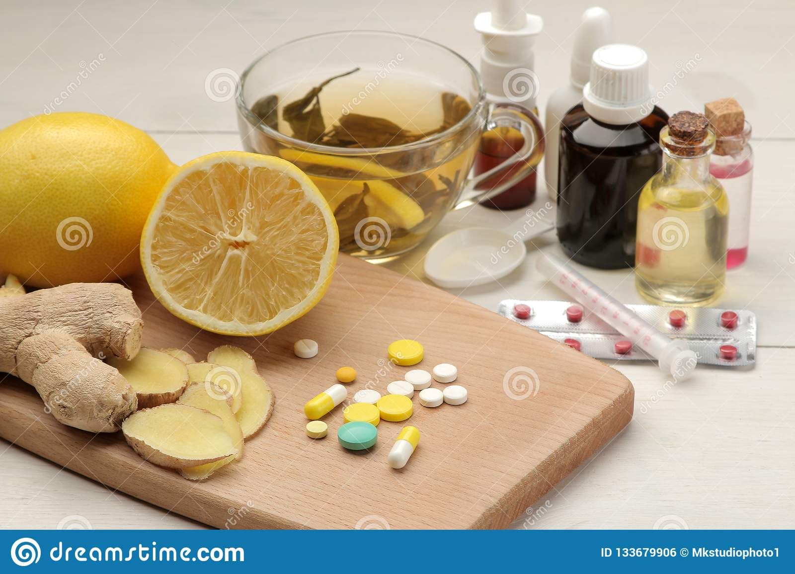 Various medicines for flu and cold remedies on a white wooden table .. Cold. diseases. cold. flu