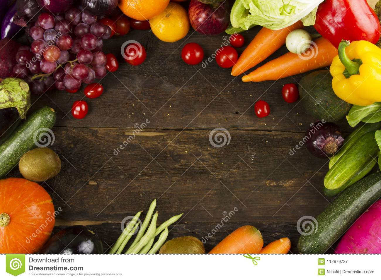 Various organic vegetable and fruits on plank wood