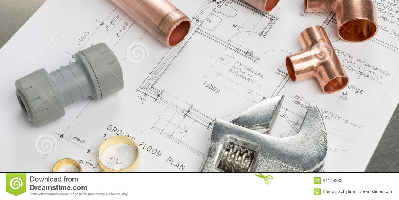 Various Plumbers Tools And Plumbing Materials On Architectural P Stock Photo