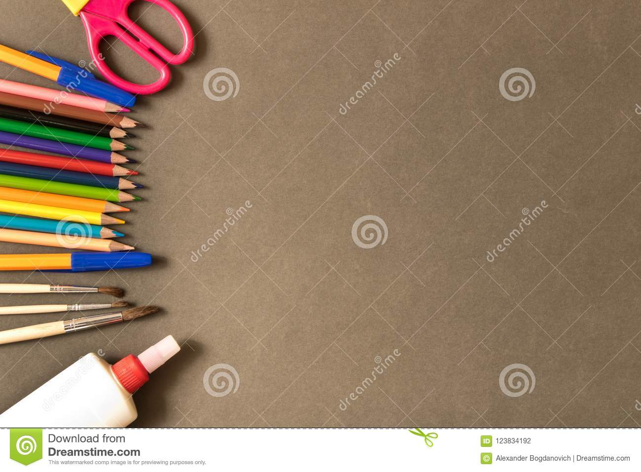 Various school supplies on the blackboard background . The concept of education. With empty space for text