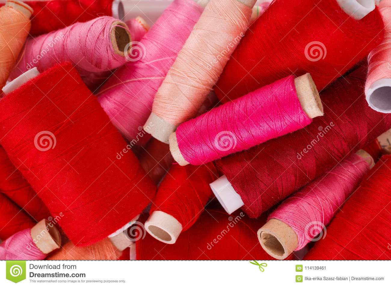 8f35c4de633e Various Shades Of Red Threads Stock Image - Image of dressmaking ...