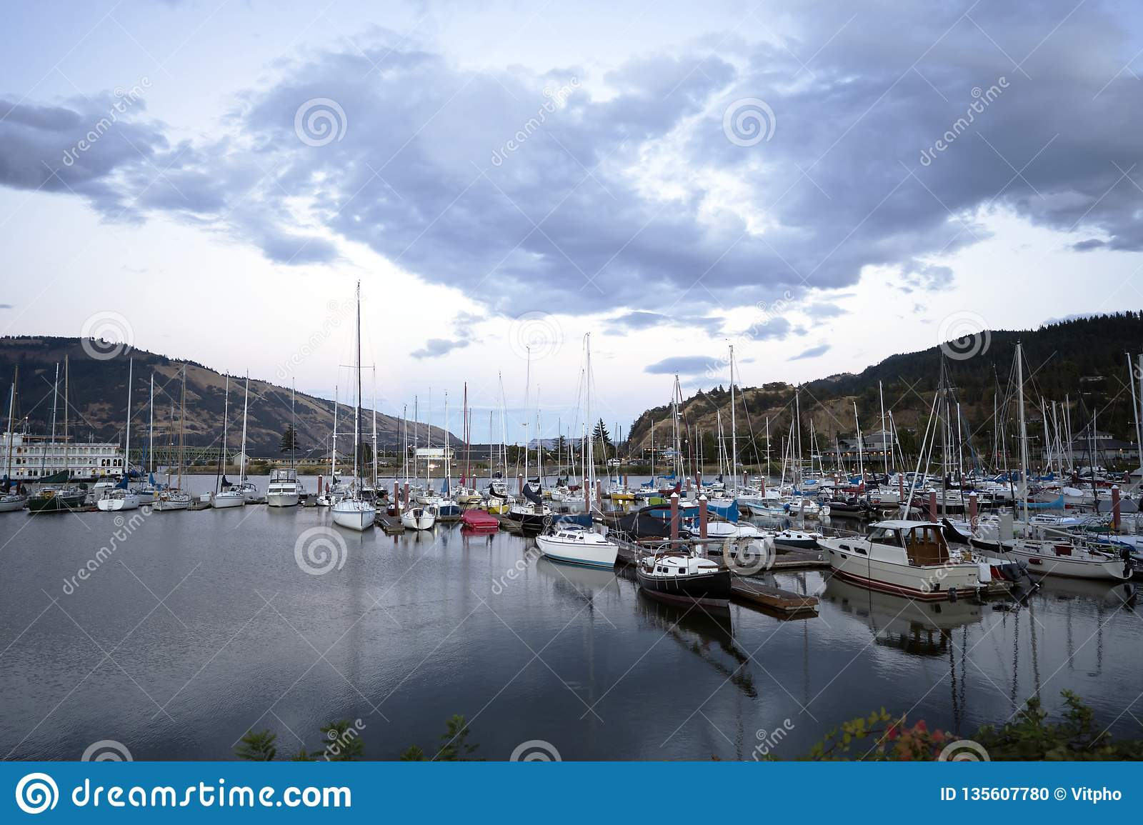 Yachts And Boats Moored At The Piers In The Bay Of The