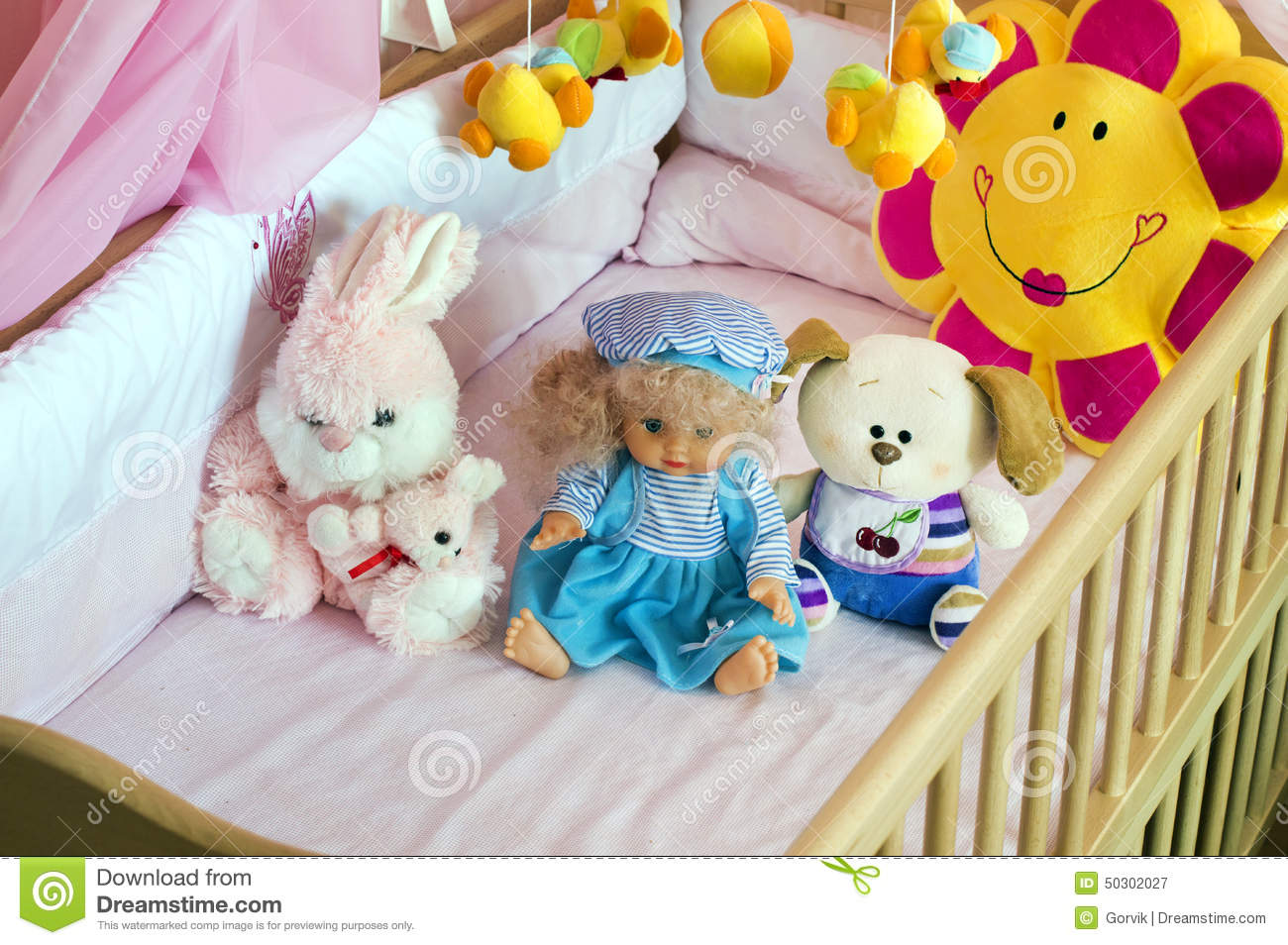 Room Filled With Soft Toys : Various soft toys in the cot with orange linen stock image