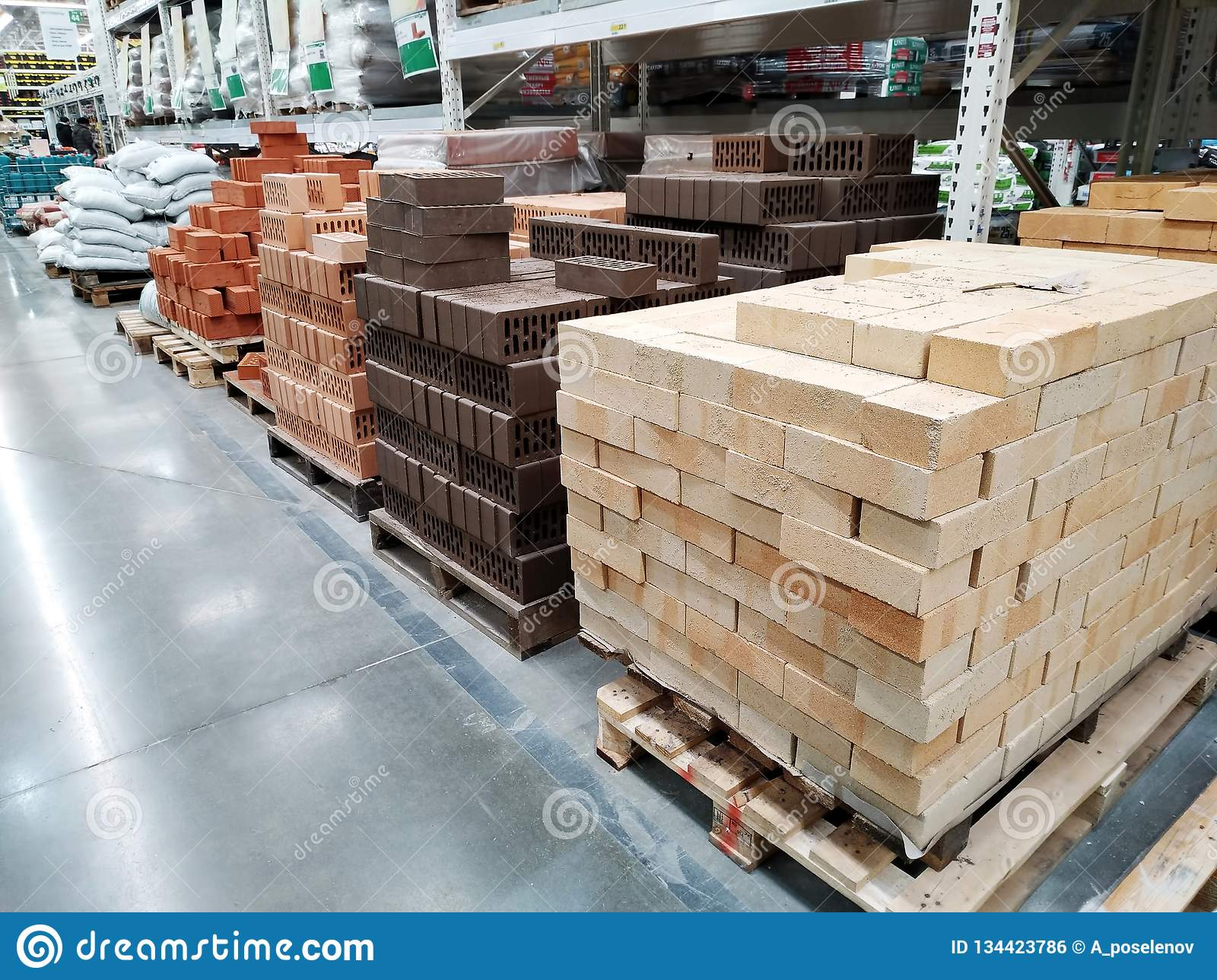 Various Sorts Of Bricks Are Sold In A Large Building