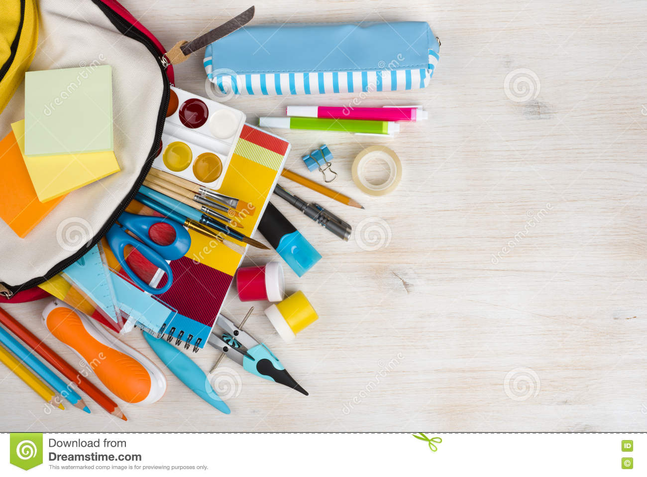 various stationery school and office supplies over wooden