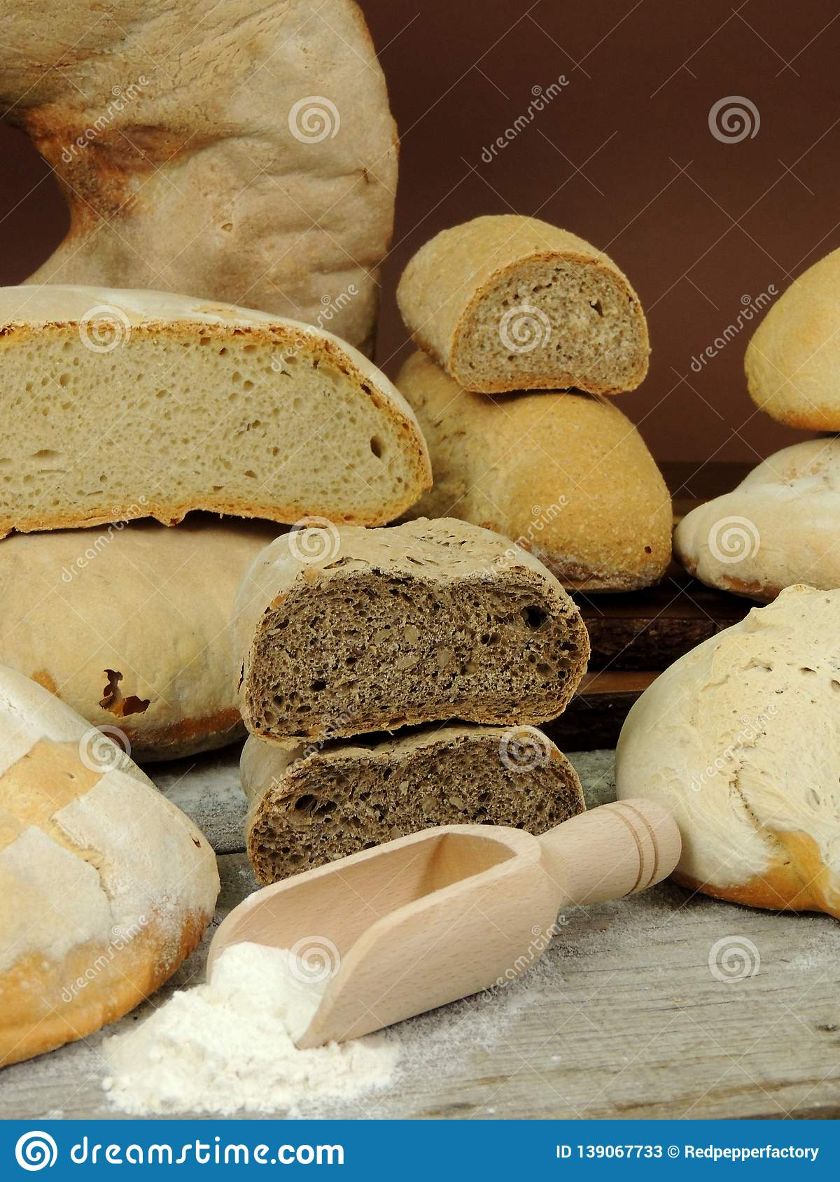 Various types of bread, white and whole grain bread loafs fresh
