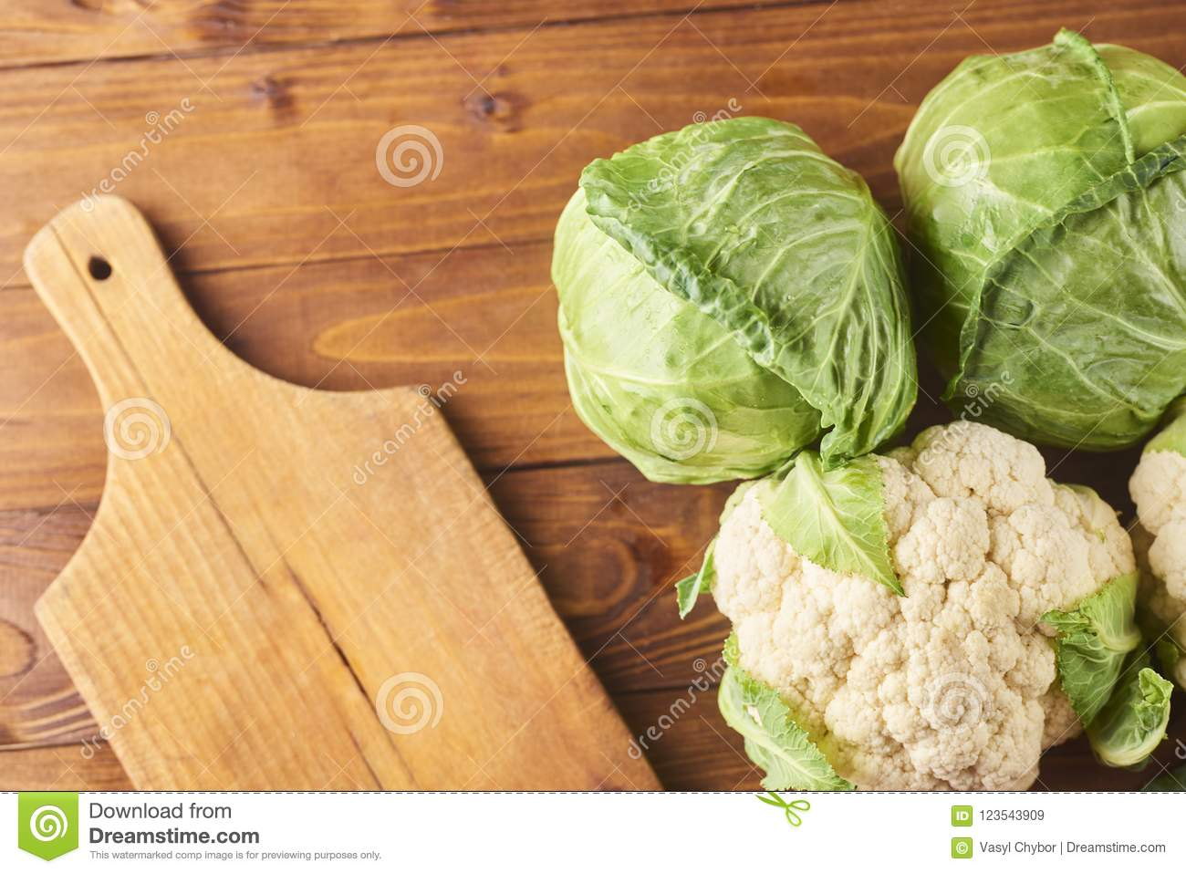 Various types of cabbage with cutting board and knife