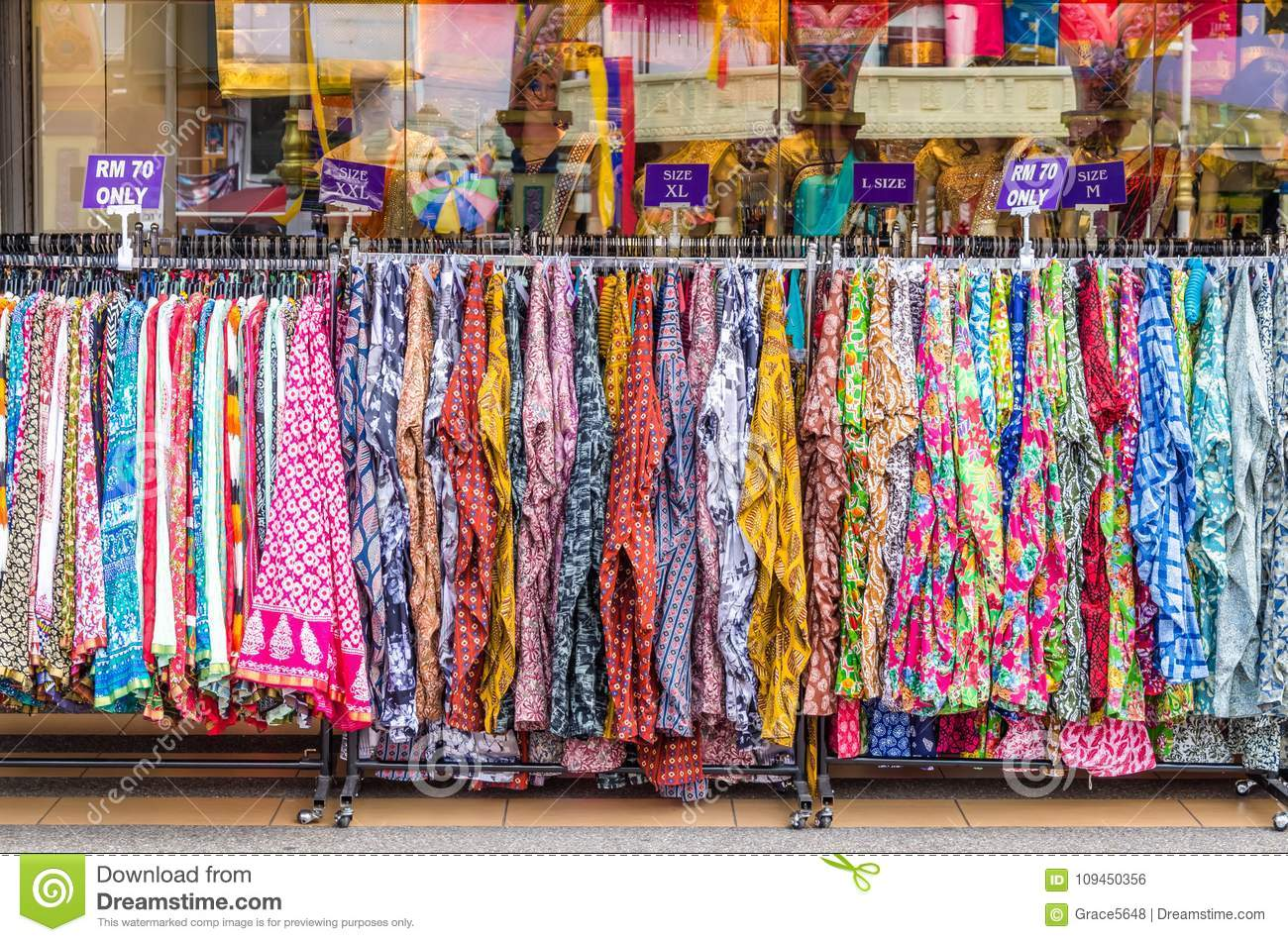 Various types of Indian fashion clothes displaying and selling in front of retail shop