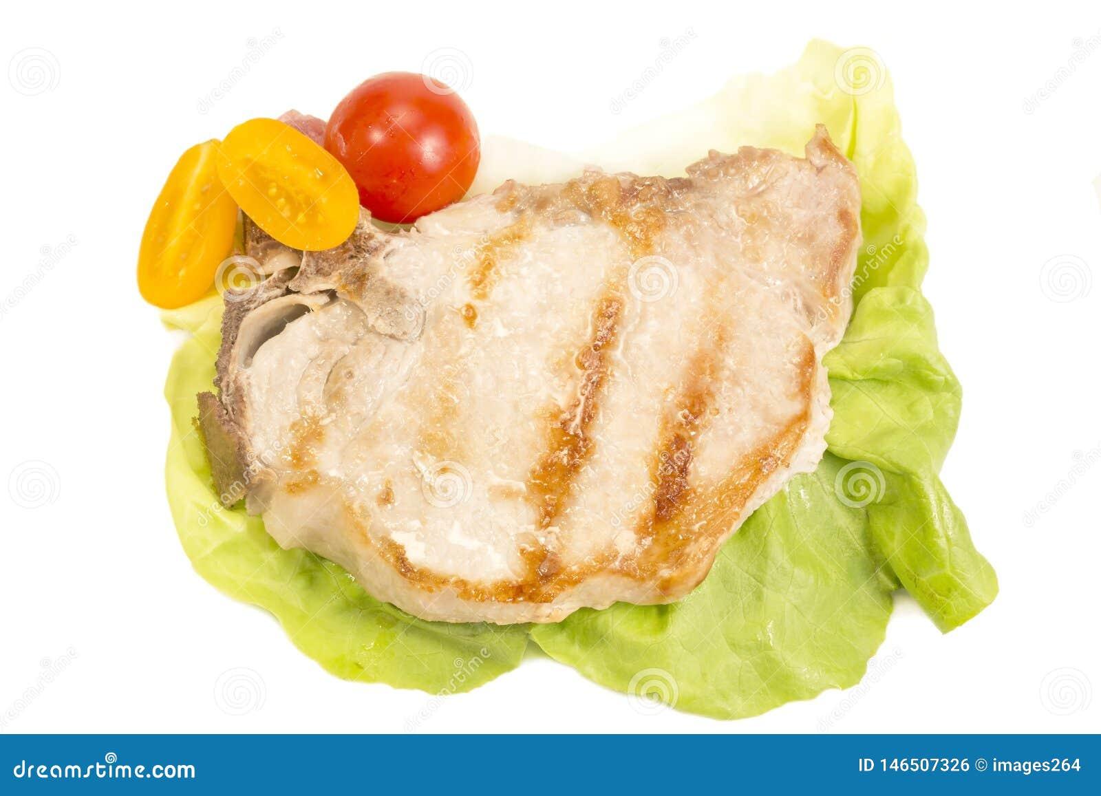 Varkensvleeslapje vlees op wit wordt ge?soleerd dat