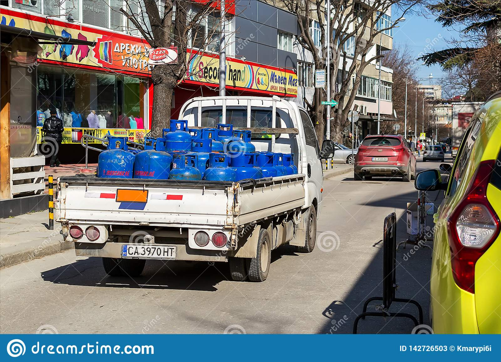 A Small Open Body Truck Carries Blue Cylinders With Compressed Gas To Customers City Delivery Of Gas Cylinders Real City Life Editorial Stock Photo Image Of Cylinder Metal 142726503