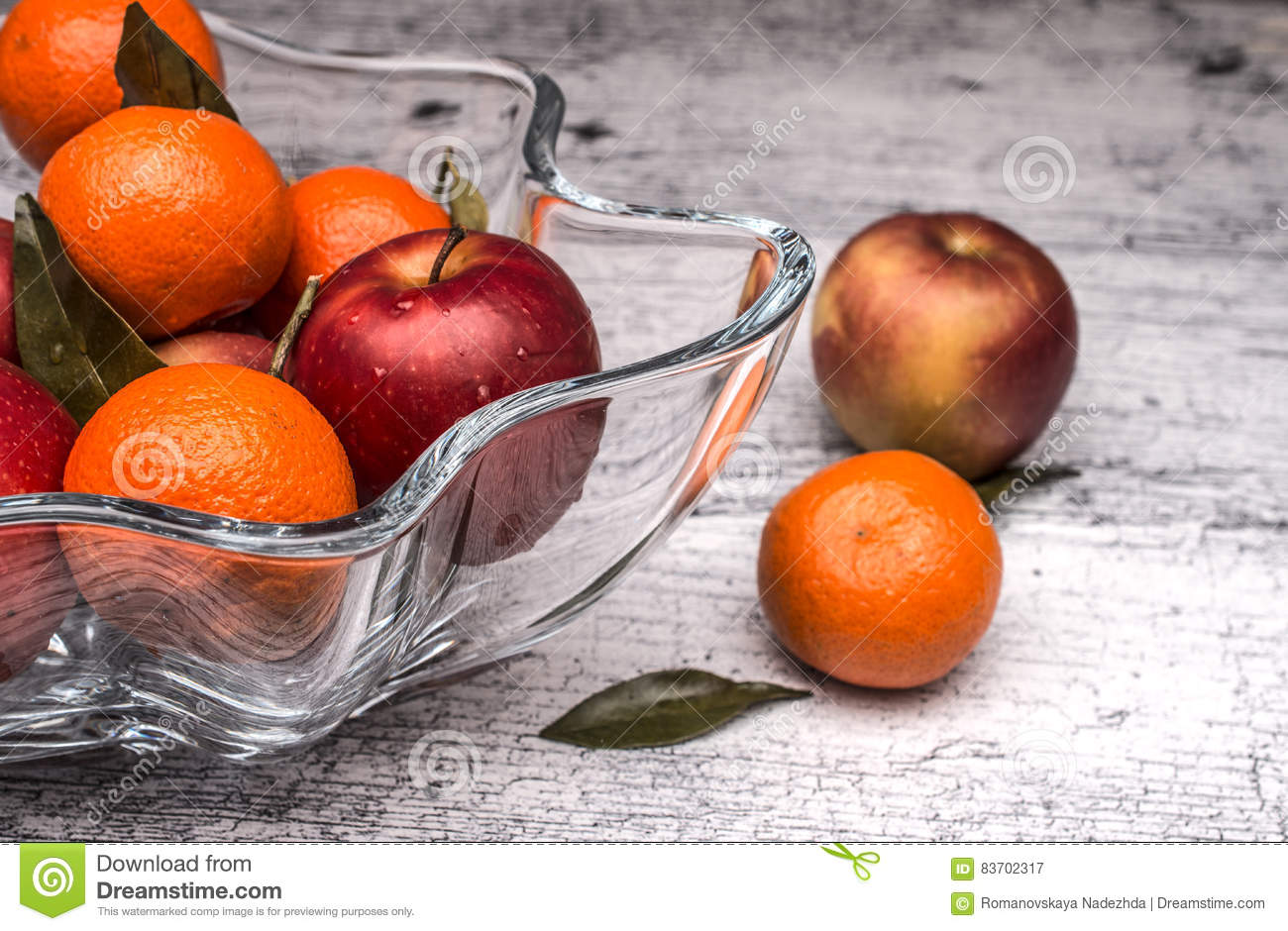 Vase With Apples And Mandarin Oranges Stock Photo