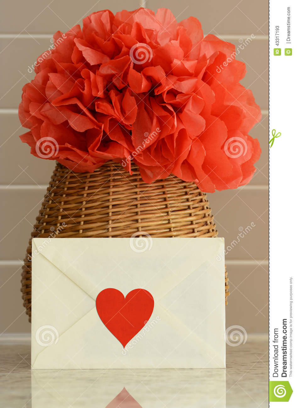 Vase Basket With Red Tissue Paper Flower On Kitchen Counter Top