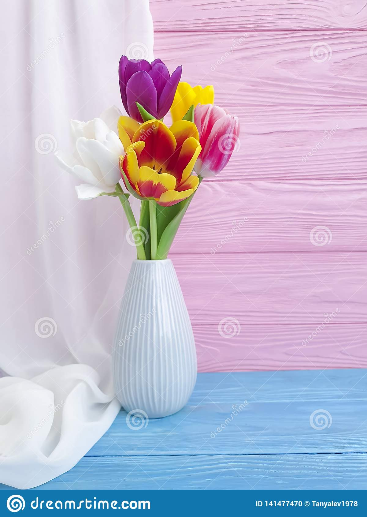 Vase bouquet of tulips colorful romantic elegance on wooden background